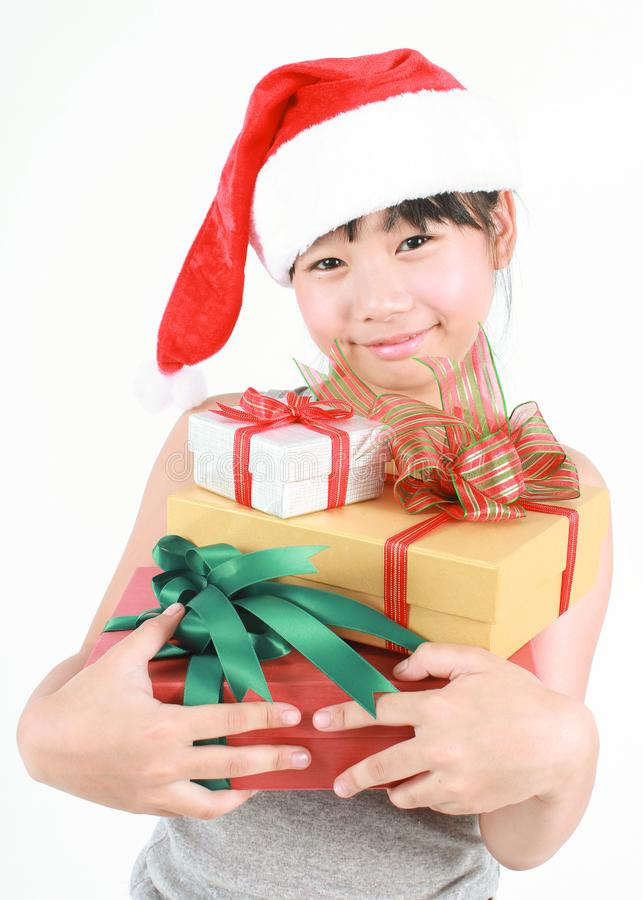 Cute asian girl wearing red hat holding boxes of gift stock images