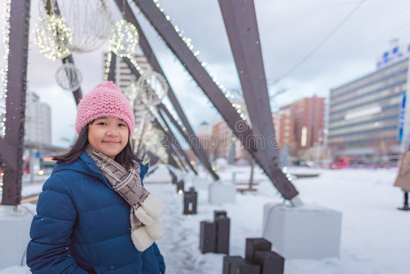 Cute asian girl in winter stock images