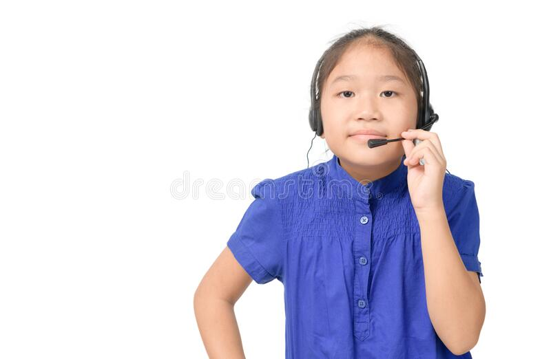 Cute asian girl is working as an operator at helpline talking with customer using headset stock photography