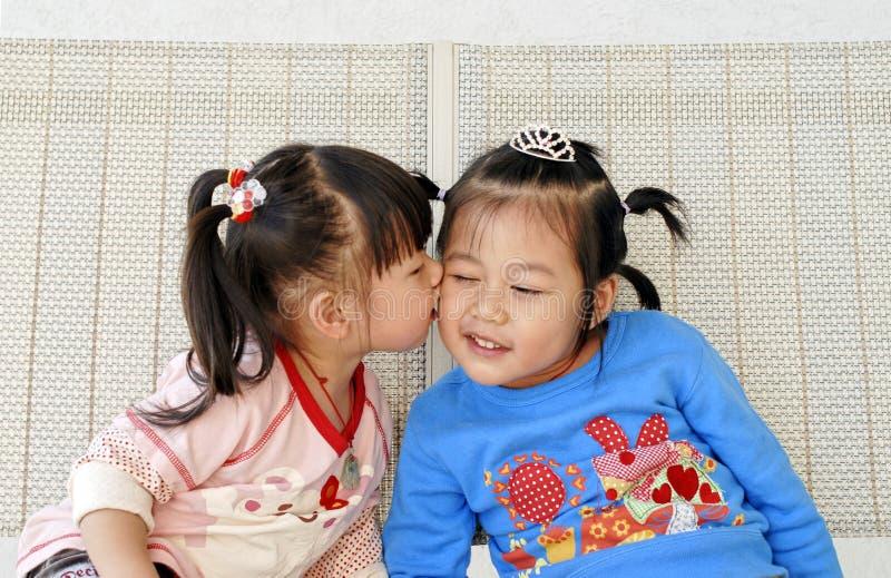 Cute Asian Girls kiss royalty free stock photo