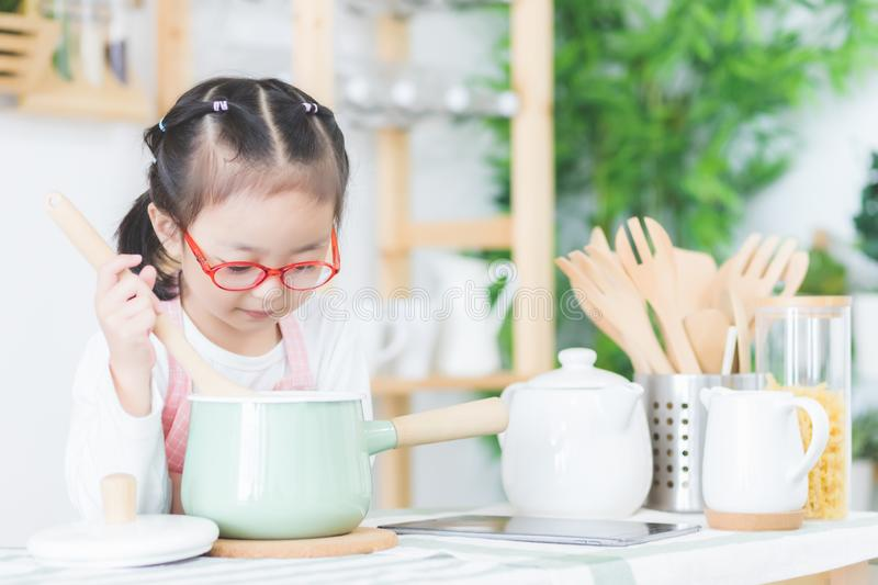 Cute Asian girls, Thai people are cooking in the kitchen at his home. royalty free stock images