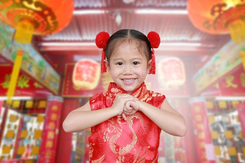 Cute asian kid girl in Traditional Chinese dress at chinese temple in bangkok thailand, Chinese new year concept royalty free stock image