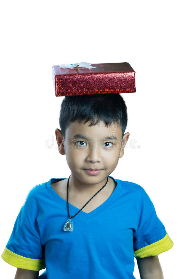 Cute asian kid put present box on his head stock photo