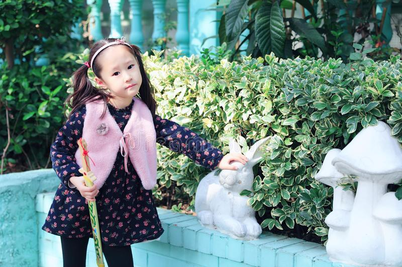 Cute Asian little beautiful girl play at autumn in the city park stock photo