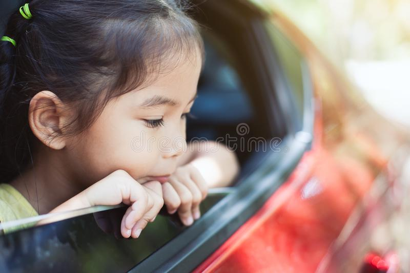Cute asian little child girl traveling by car stock image