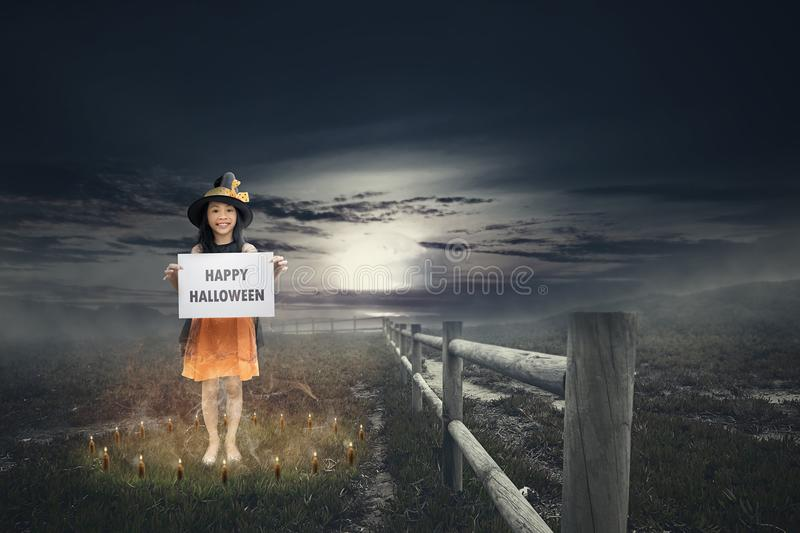 Cute asian little girl with Happy Halloween greeting. Halloween concept royalty free stock photo