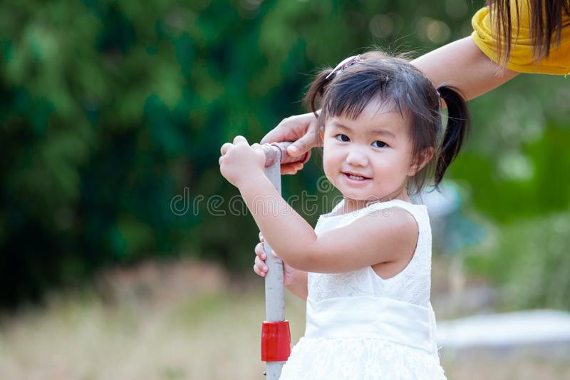 Cute asian little girl smiling and playing in the park stock photos