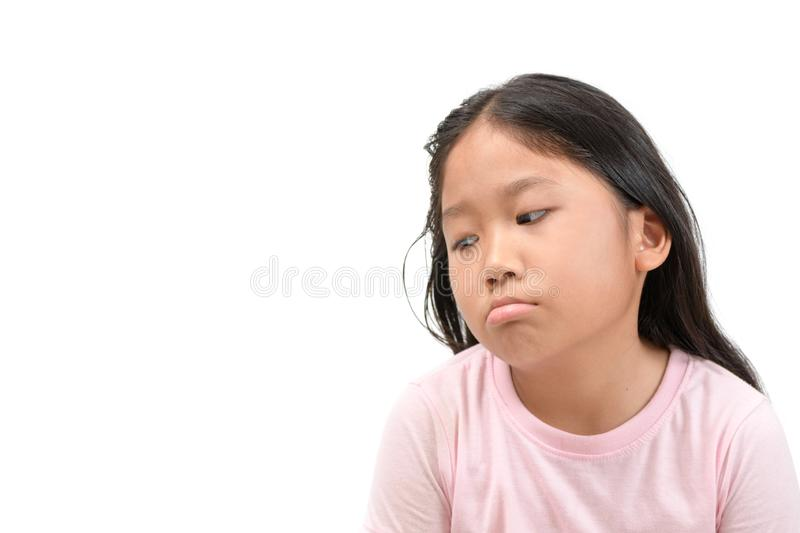 Cute asian  school girl bored and tired boredom. Isolated on white background, face emotion concept stock photography