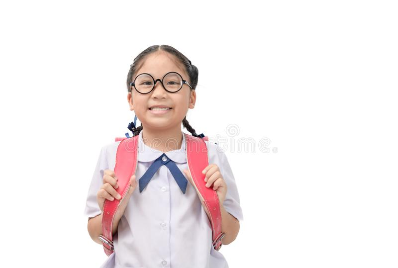 Cute asian student smile and carry school bag royalty free stock photo
