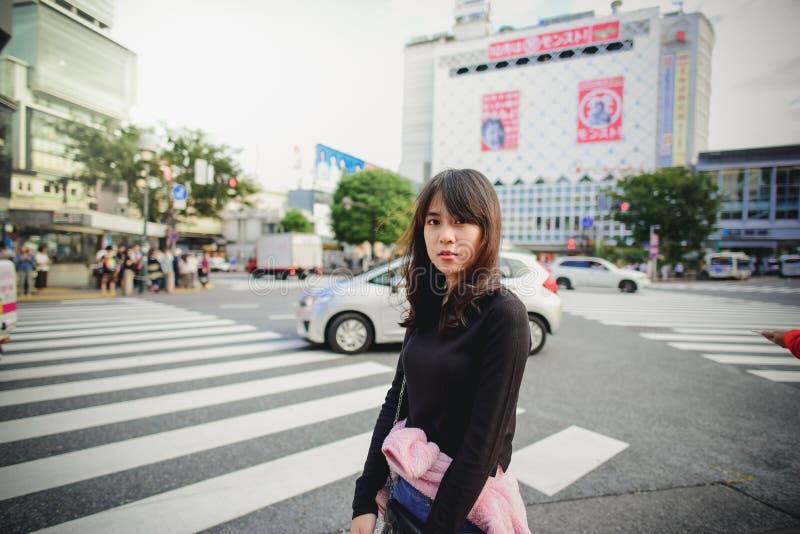 Cute Asian teenager girl walking in Harajuku street, Tokyo. Stan stock images