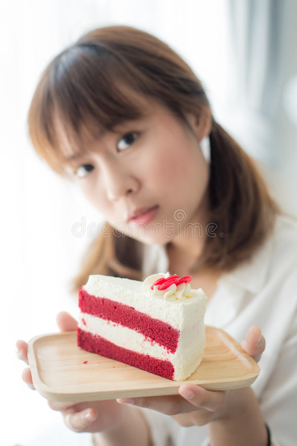 Cute Asian teenager holding strawberry cake stock photos