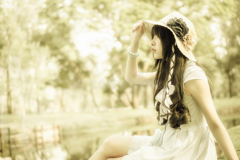 A cute Asian Thai girl is looking in the sky with hope stock images