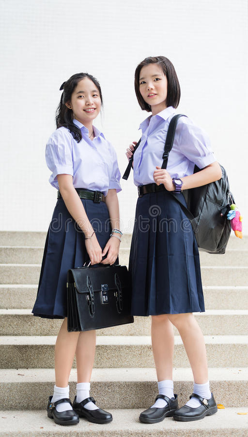 Cute Asian Thai high schoolgirls student couple standing royalty free stock photo