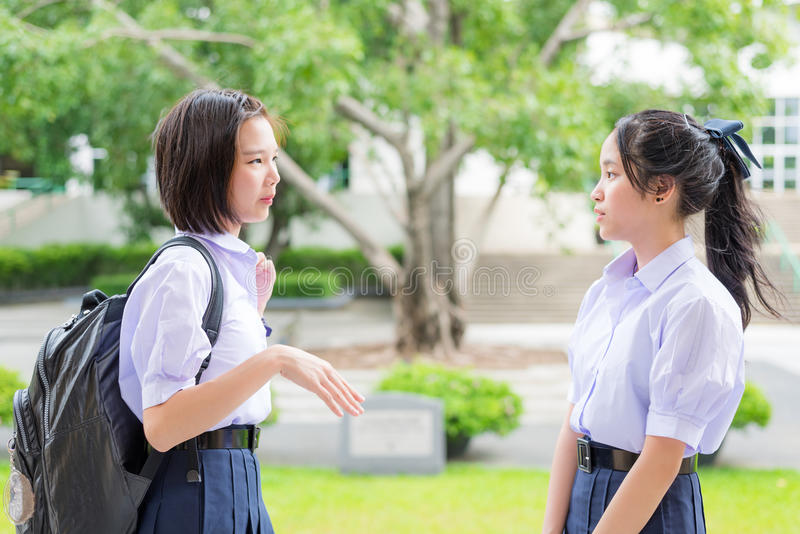 Cute Asian Thai high schoolgirls student talking stock photography