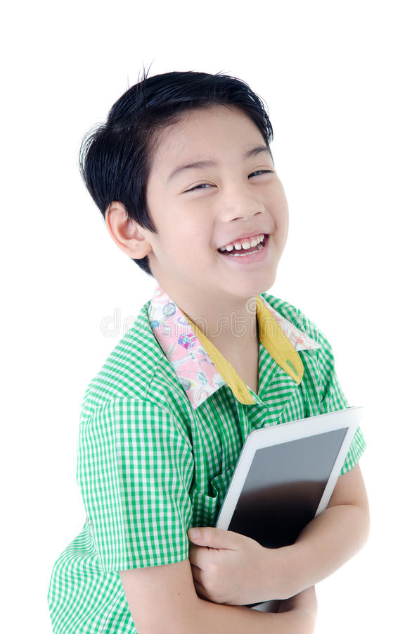 Cute asian Thailand boy with tablet computer on isolated background . stock images
