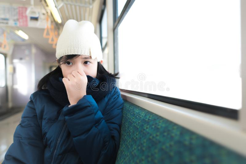 Cute asian on train stock image