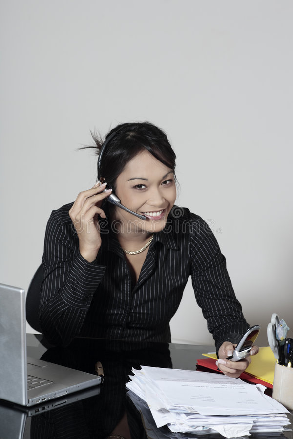Cute asian working woman stock image