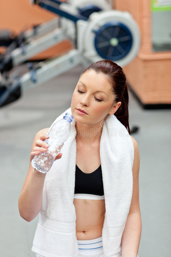 Cute athletic woman drinking water stock photo