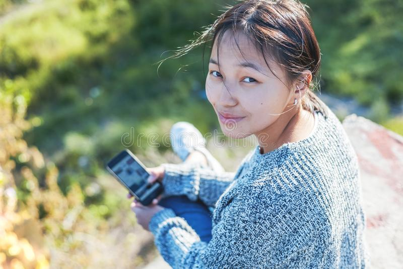 Cute attractive stylish asian girl teenager 15-16 years old on c royalty free stock photo
