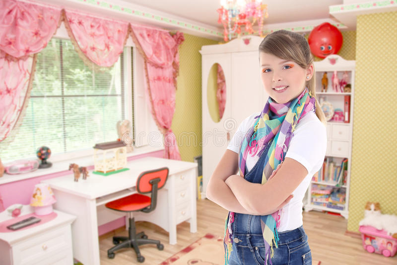Cute attractive teenage girl in his room stock photography