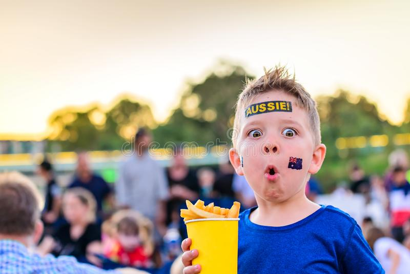 Cute Australian boy with flag tattoo on his face. On Asutralia Day celebration in Adelaide royalty free stock image