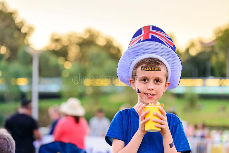 Cute Australian boy with flag tattoo on his face. On Asutralia Day celebration in Adelaide stock image