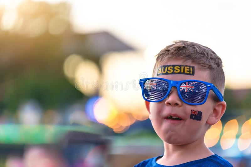 Cute Australian boy with flag tattoo on his face. On Asutralia Day celebration in Adelaide royalty free stock photo