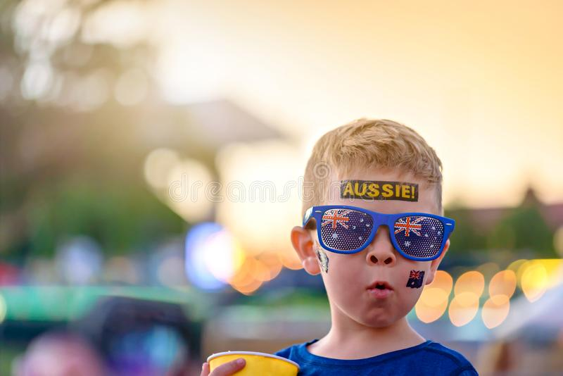 Cute Australian boy with flag tattoo on his face. On Asutralia Day celebration in Adelaide stock photo