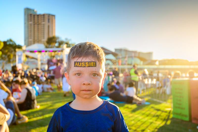 Cute Australian boy with tattoo on his face. On Australia Day celebration in Adelaide city stock image
