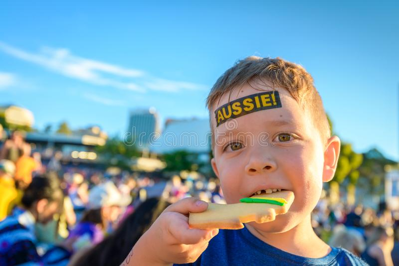 Cute Australian boy with tattoo on his face. On Australia Day celebration in Adelaide city stock images