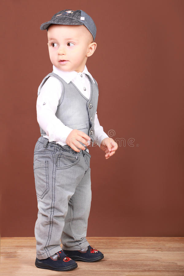 Cute babe in denim suit stock photography