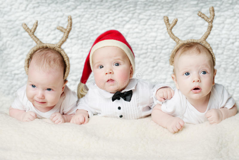 Cute babies with deer horns royalty free stock photos
