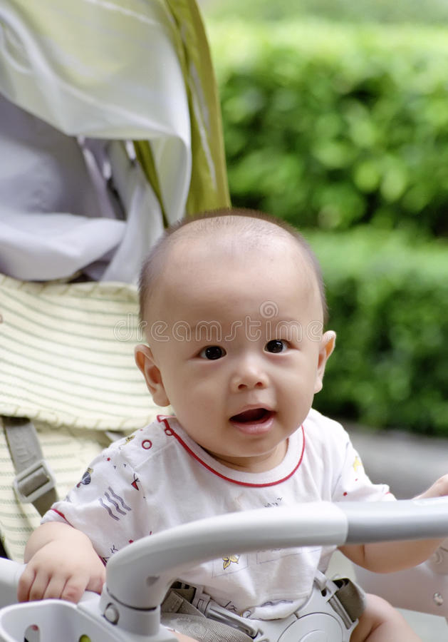 Download Cute baby stock image. Image of expression, foot, active - 12135007
