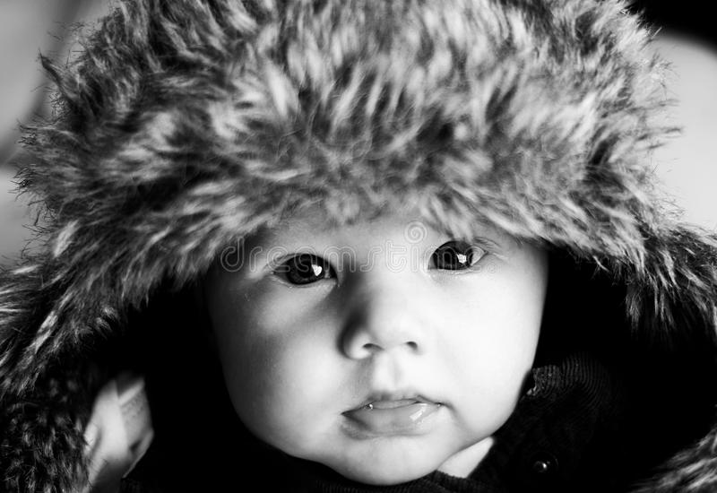 Cute baby with adults hat stock photos