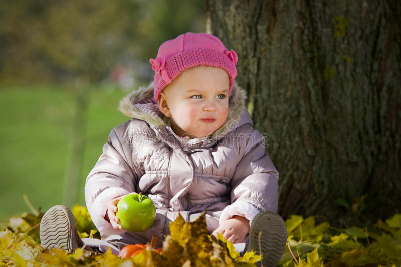 Download Cute Baby With Apple Royalty Free Stock Photo - Image: 16779225