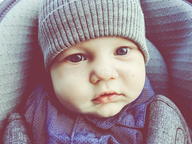 Cute baby in a baby car seat royalty free stock photography