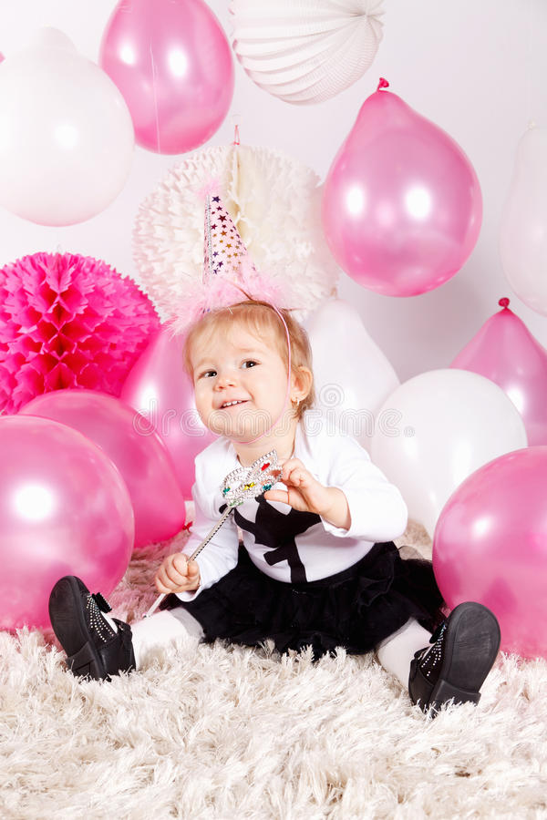 Cute baby with balloons royalty free stock photos