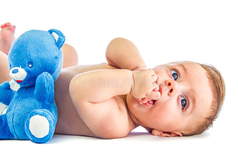 Cute baby with bear stock photo