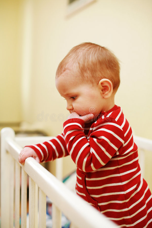 Cute baby in bed royalty free stock photos
