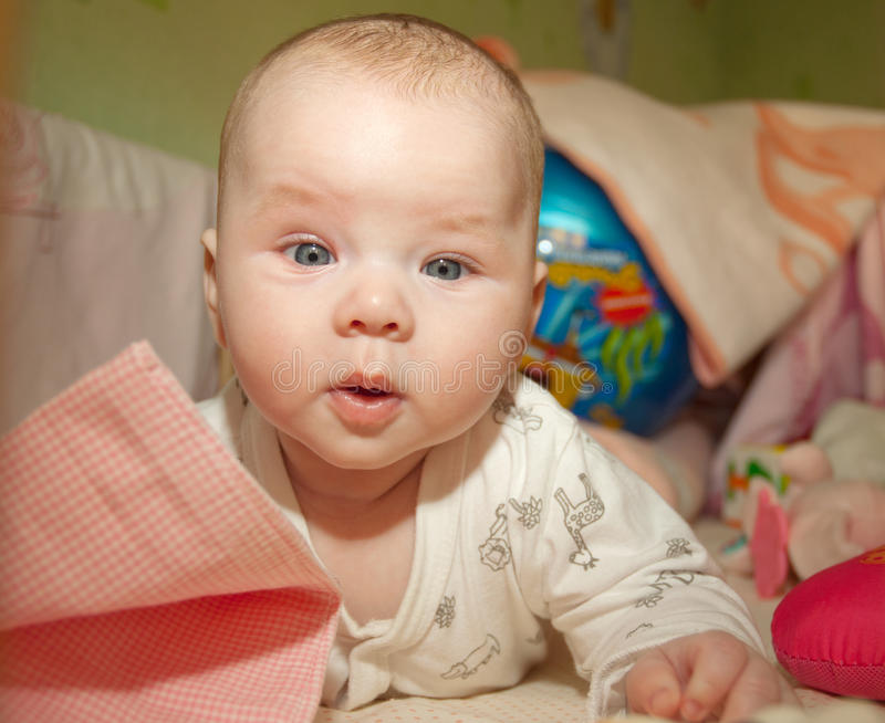 Cute baby in bed royalty free stock photo