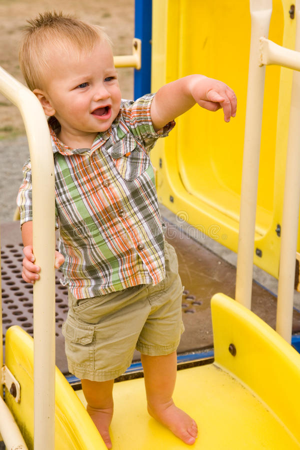Cute Baby Boy. A portrait of a cute one year old baby boy at a park stock photo