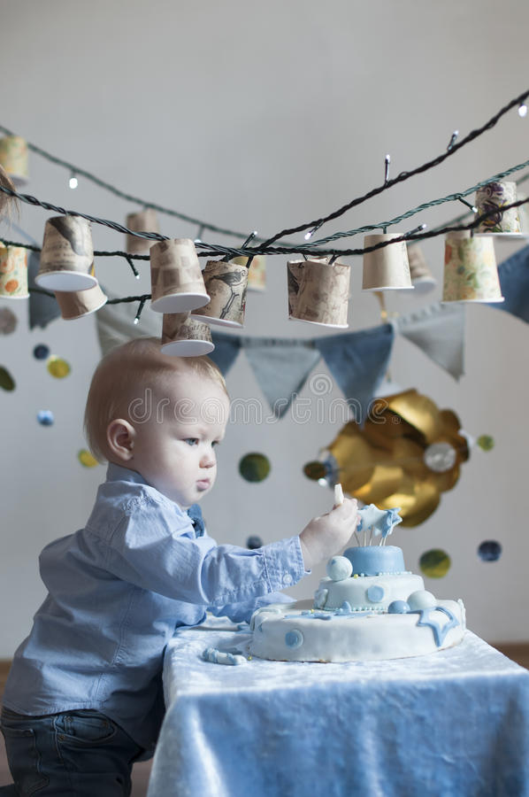 Cute baby boy with cake royalty free stock images