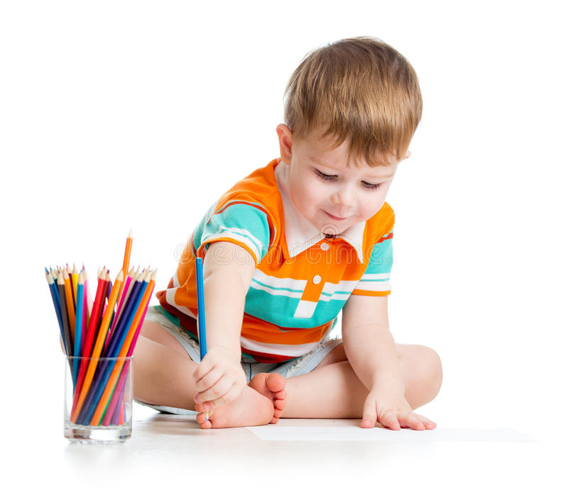 Cute baby boy drawing with color pencils royalty free stock images