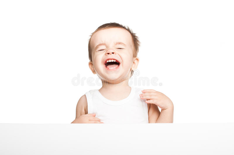 Cute baby boy holding empty blank board stock photo
