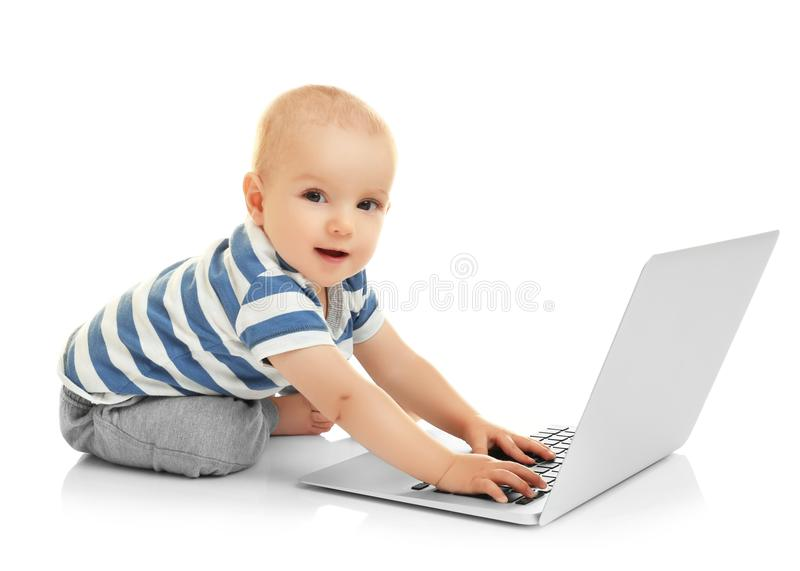 Cute baby boy with laptop stock photo