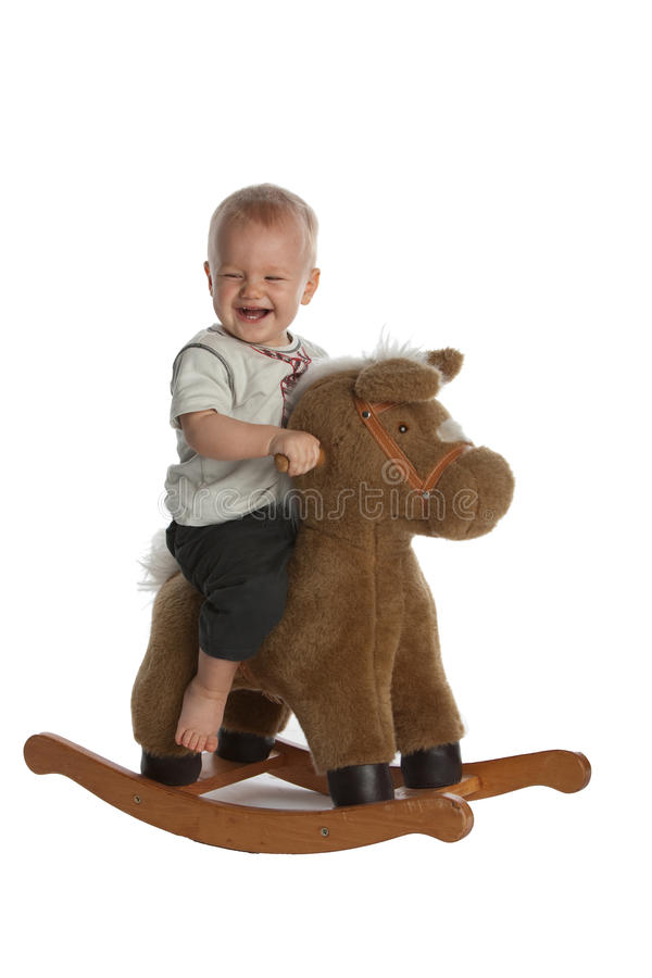 Cute Baby Boy Laughing On Rocking Horse Stock Photography