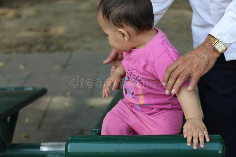 Cute baby boy playing in park. stock photo