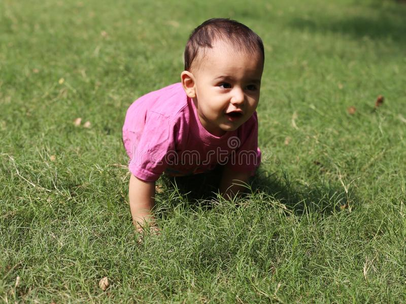 Cute baby boy playing in park. royalty free stock photos