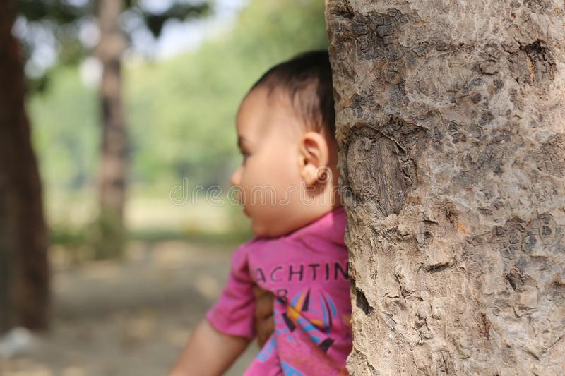 Cute baby boy playing in park. stock image