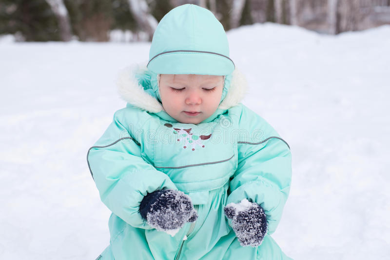 Cute baby boy playing in park in winter stock photography